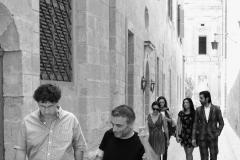 Paul Gordon from CARAVAN in conversation with Artistic Director Dr. Giuseppe Schembri Bonaci with the Mdina Biennale Action Group in the background
